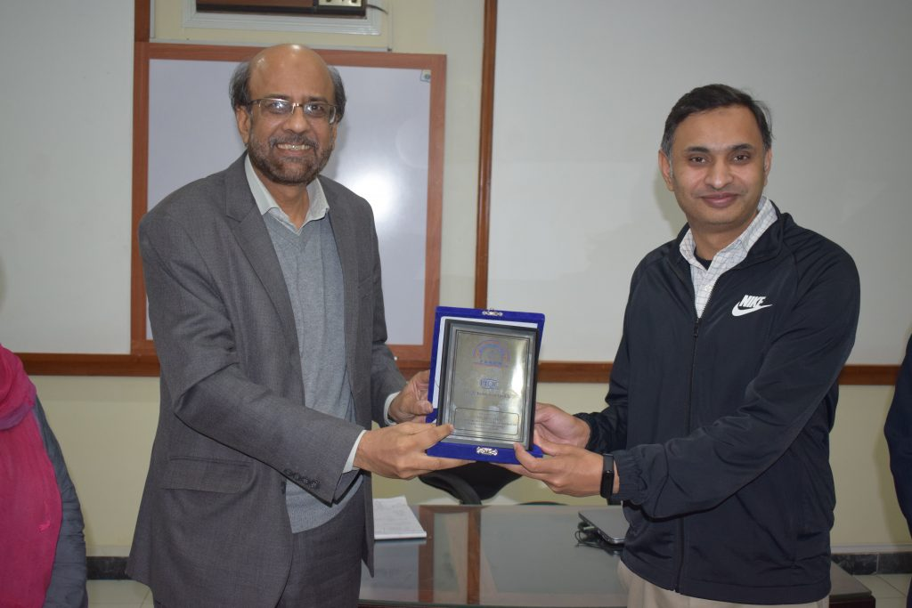 Presenting Shield to Mr. Amir Hussain